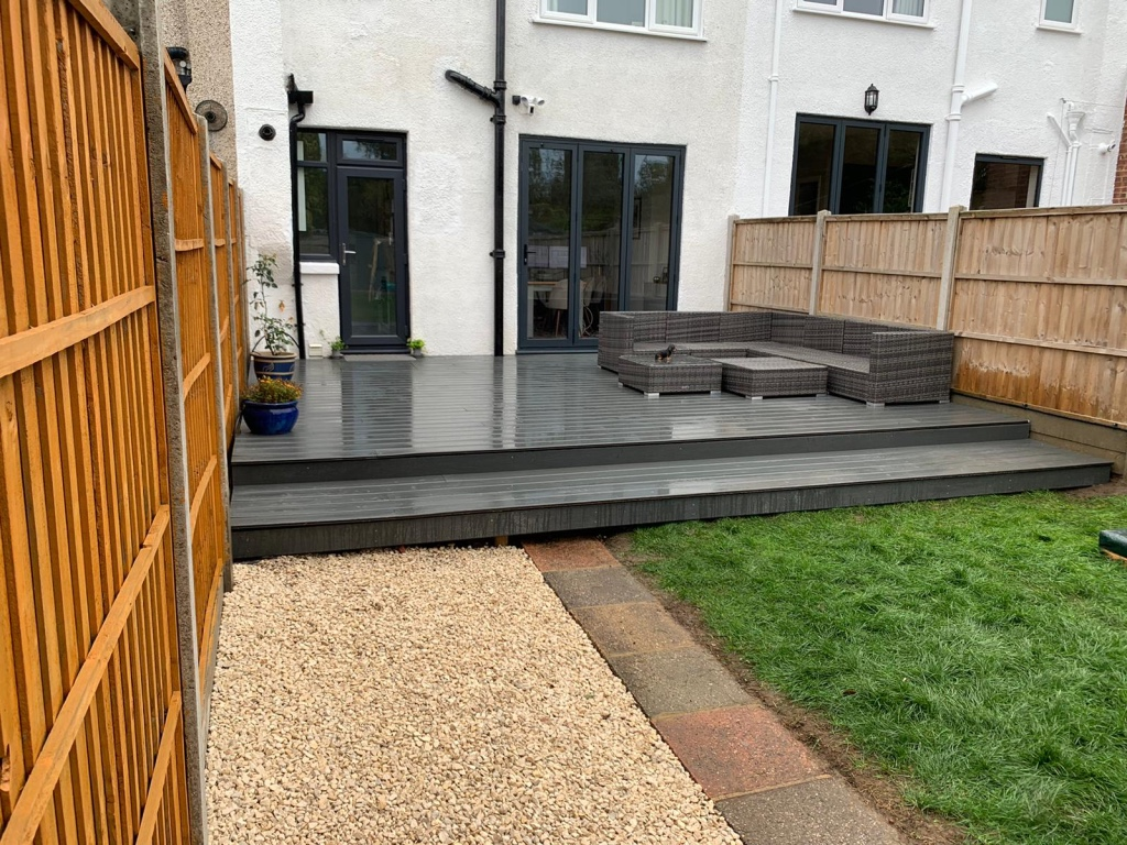 Complete back garden landscaping and new grass
